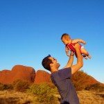 Entertaining a chubby baby, waiting for Olgas sunset