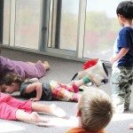 Kids practicing yoga at the Contemporary Art Museum (CAM)