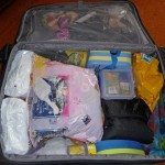 Packed suitcase, with lots of room to spare. Nappies can be taken out and stored in the front if require more space.