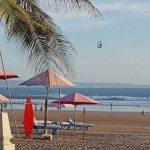 Royal Beach Seminyak beach and a hawker flying pirate ship kite
