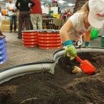 These kids could stay awhile digging in the soil