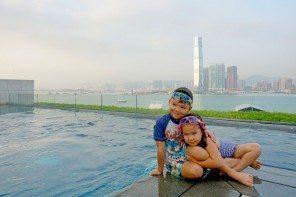 Four Seasons Hotel Hong Kong. The kids swimming at sunset in Hong Kong. Best infinity pool in Hong Kong.