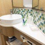 Vanity and basis in refurbished bathroom.