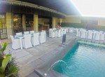Dine while kids splash, restaurant is poolside