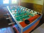 Kids can play foozball. Pizza Bagus