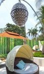Sofitel Singapore Sentosa Resort and Spa. Jeweled lantern and shaded sun lounges by the pool