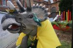 """A few dino's leftover from last year were """"dressed up"""" in a tea party theme. It's OK."""