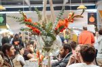 Cape Town's Neighbourgoods Market with shared long tables and floral displays. Image: Nadia Akester