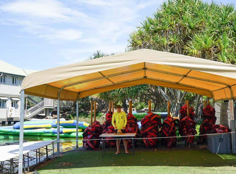 Mandatory life jackets to be worn for good clean jumping fun at Aqua Fun Park, Novotel Twin Waters Resort. Best family accommodation Sunshine Coast.